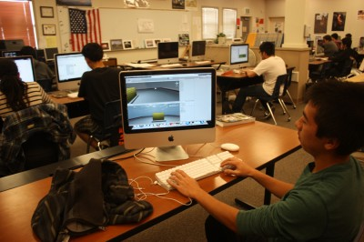 Digital design students work on creating a new app