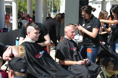 Volunteers shave it off for cancer