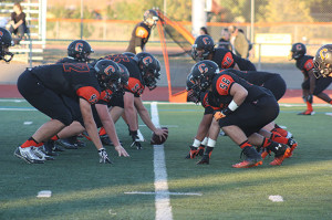The Cal High Football Team Warms Up for Their Game Against Granada