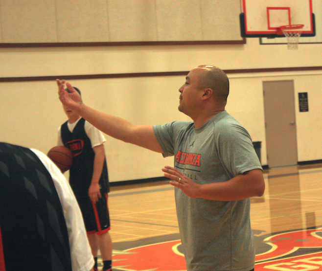 Math teacher takes on men's basketball