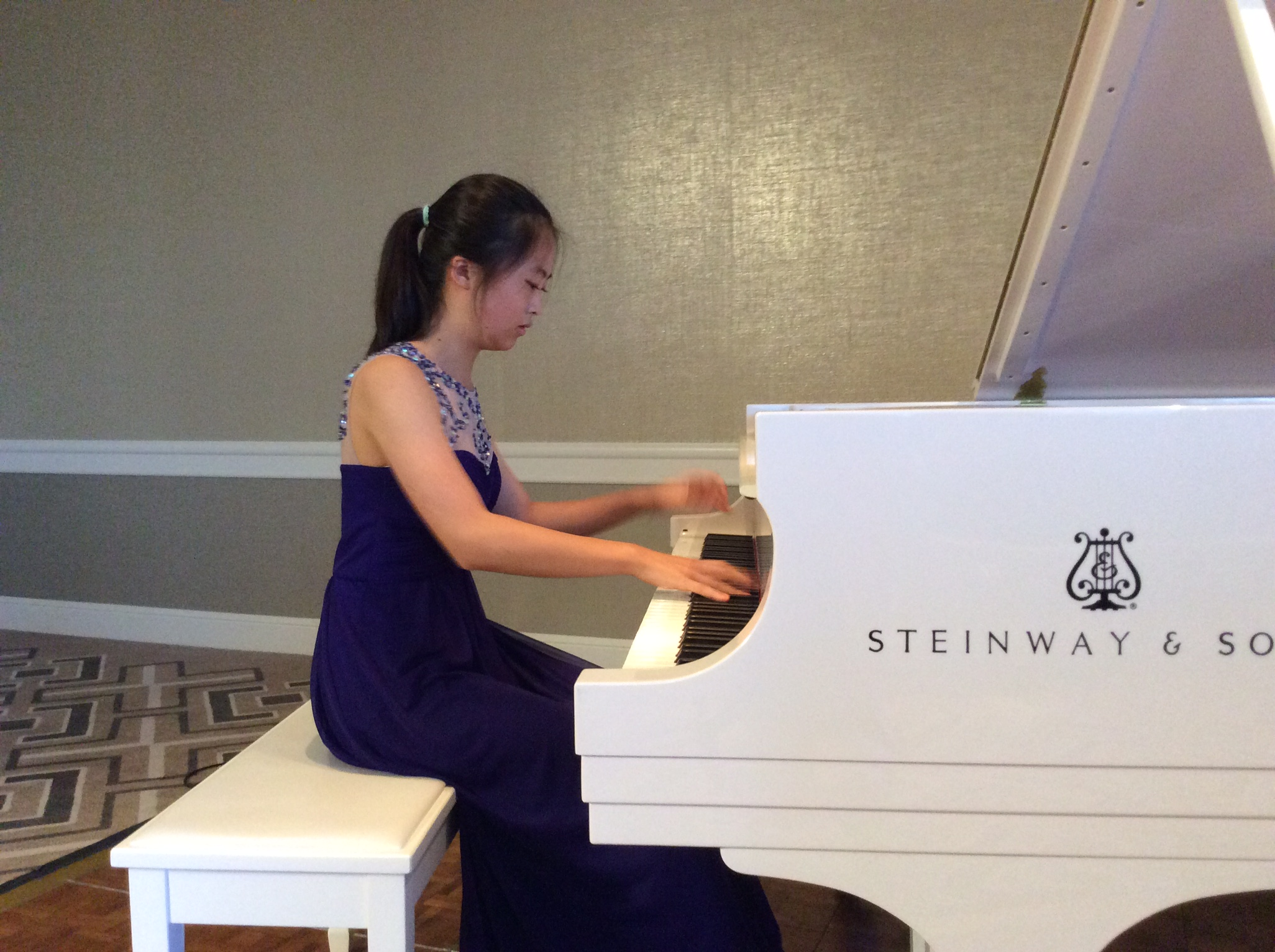 Minju Kim practices for hours on end, working toward her next achievement. She has received much acclaim for her talent, including playing at Carnegie Hall in New York City.