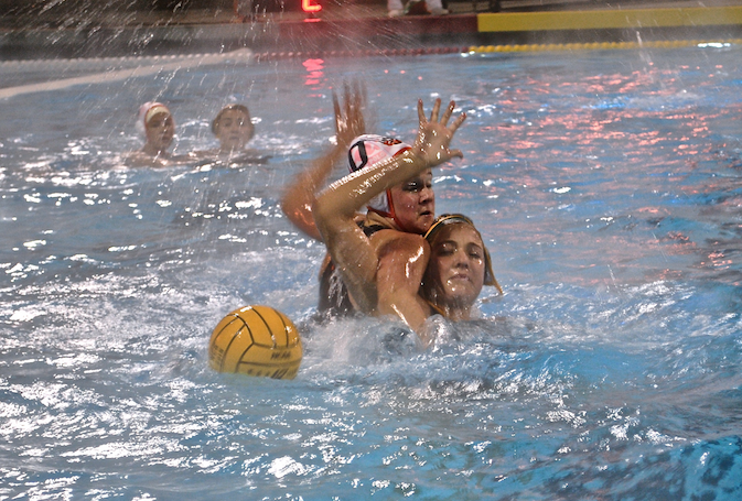 Junior+Taylor+Hammil%2C+left%2C+blocks+San+Ramon+Valley+High+School+player+in+NCS+semifinals.+The+women%E2%80%99s+water+polo+team%E2%80%99s+great+season+came+to+an+end+after+an+18-3+loss+in+this+game.+