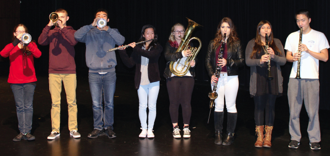 From left to right, senior Katelyn Hefter, freshman Kurt Krempel, senior James Taniguchi, junior Kristen Gao, sophomore Holly Mentink, junior Danielle Anderson, sophomore Karina Hazari, and senior Henry Sun are the eight Cal High students who will be performing with the Contra Costa Honor Band on Saturday.
