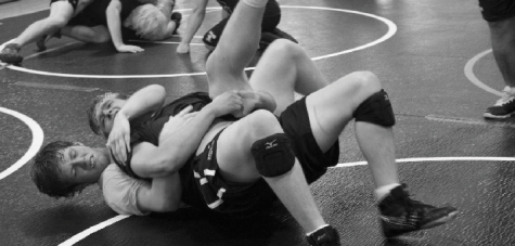 Senior Gerrick Labra, bottom,  and junior Blaine Nye practice for playoffs.  Labra won two matches at the state finals.