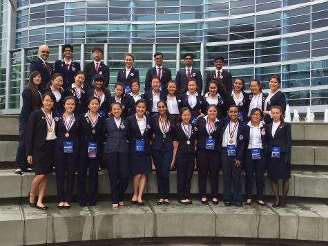 Cal High's HOSA competitors and adviser Andrew White, back row far left, pose in front of the Anaheim Convention Center during the State Leadership Conference April 7-10. Nine Cal students qualified for the national competition in June.