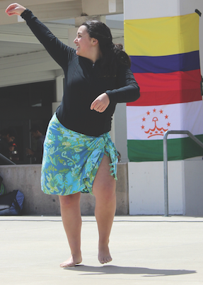 Junior Sara Zettle celebrates Cal's diverse cultures through performing a Tahitian dance on stage.