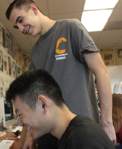 Above, former editors Austin Hille, standing, and Ryan Zhang collaborate on an issue of The Californian.