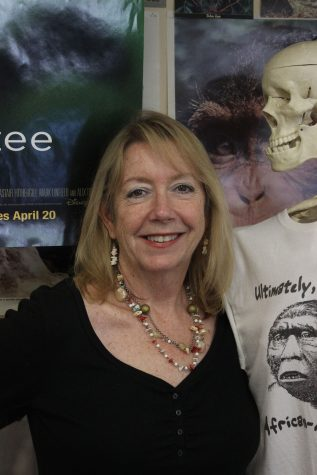 Biology teacher Julie Bitnoff, hanging with her skeleton friend, will remember her three-plus decades at Cal fondly.