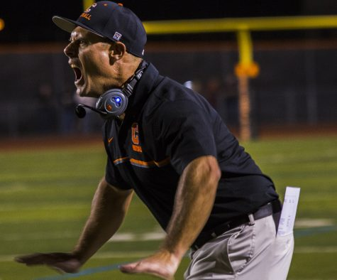 Varsity football coach Eric Billeci shouts instructions to his team during last week's game.