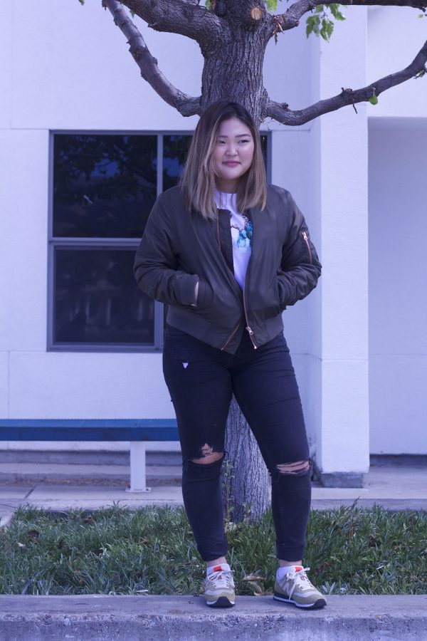 Junior Iris Kang modeling off her stylish bomber jacket.