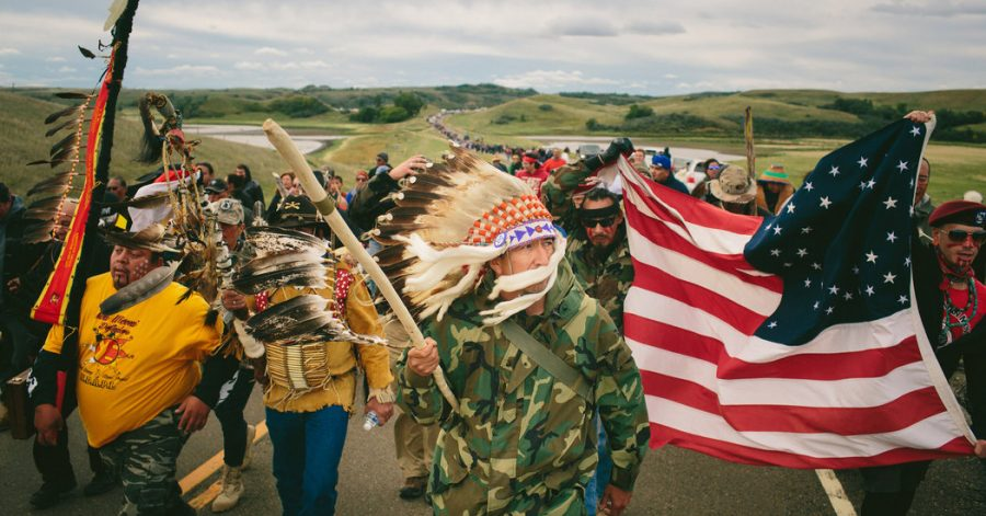Protesters, including army veterans, join together to peacefully oppose against the construction of the Dakota Pipeline.
