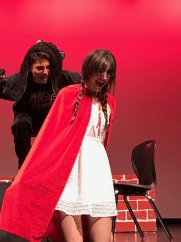 Senior River Moore and sophomore Zoe Whitaker in their roles as The Wolf and Little Red Riding Hood.