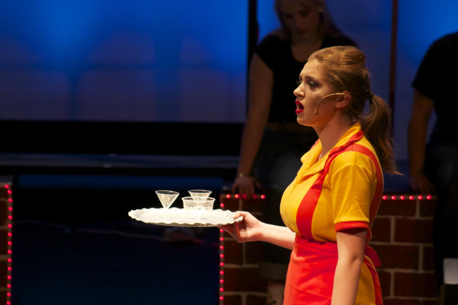 "Sophomore Claire O'Connor in ""It's an Art"" in her role as a spunky Italian waitress struggling to get by.  Many students sang solos about the working class. ""Working"" ran through from April 27-April 29."