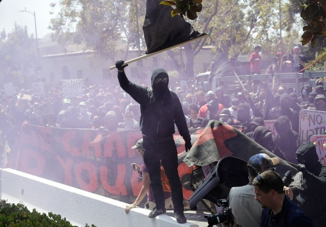 A protester from the alt-left organization ANTIFA stirs up the crowd in Berkeley on Aug. 27. Thousands of pretesters came together in Berkeley and San Francisco to day before in response to planned speeches from conservative groups Patriot Prayer and No Marxism.