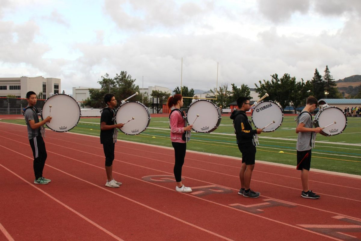 Cal High's marching band drummers practice in formation for the upcoming performances of the year.