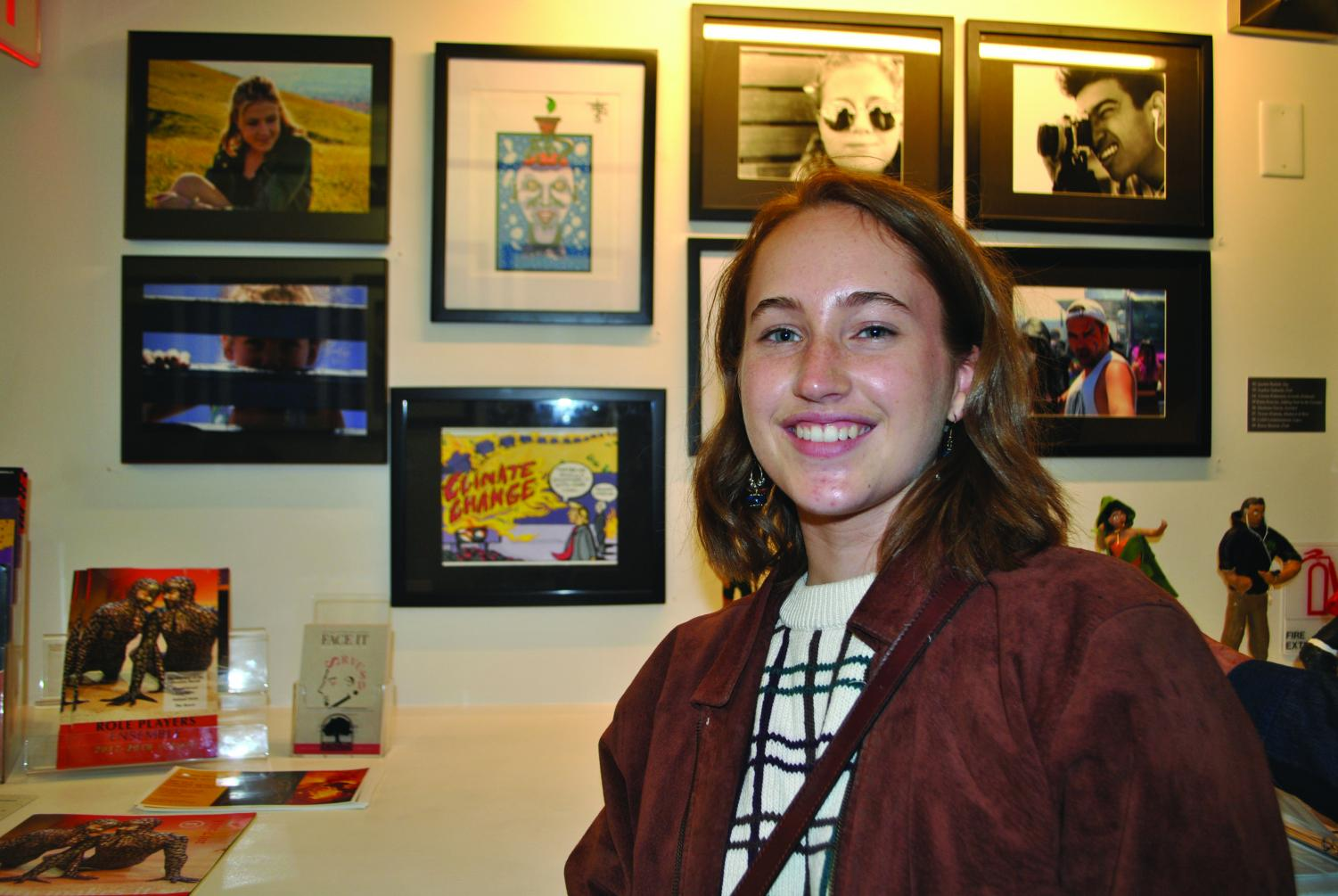 Senior Katie Kravitz displays her digital artwork at the Face It district art show.