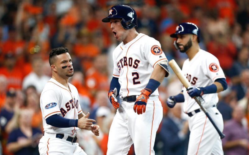 Astros' stars Alex Bregman (2) and Jose Altuve celebrate during their 7-2 win over the Indians in Game 1 of the ALDS.