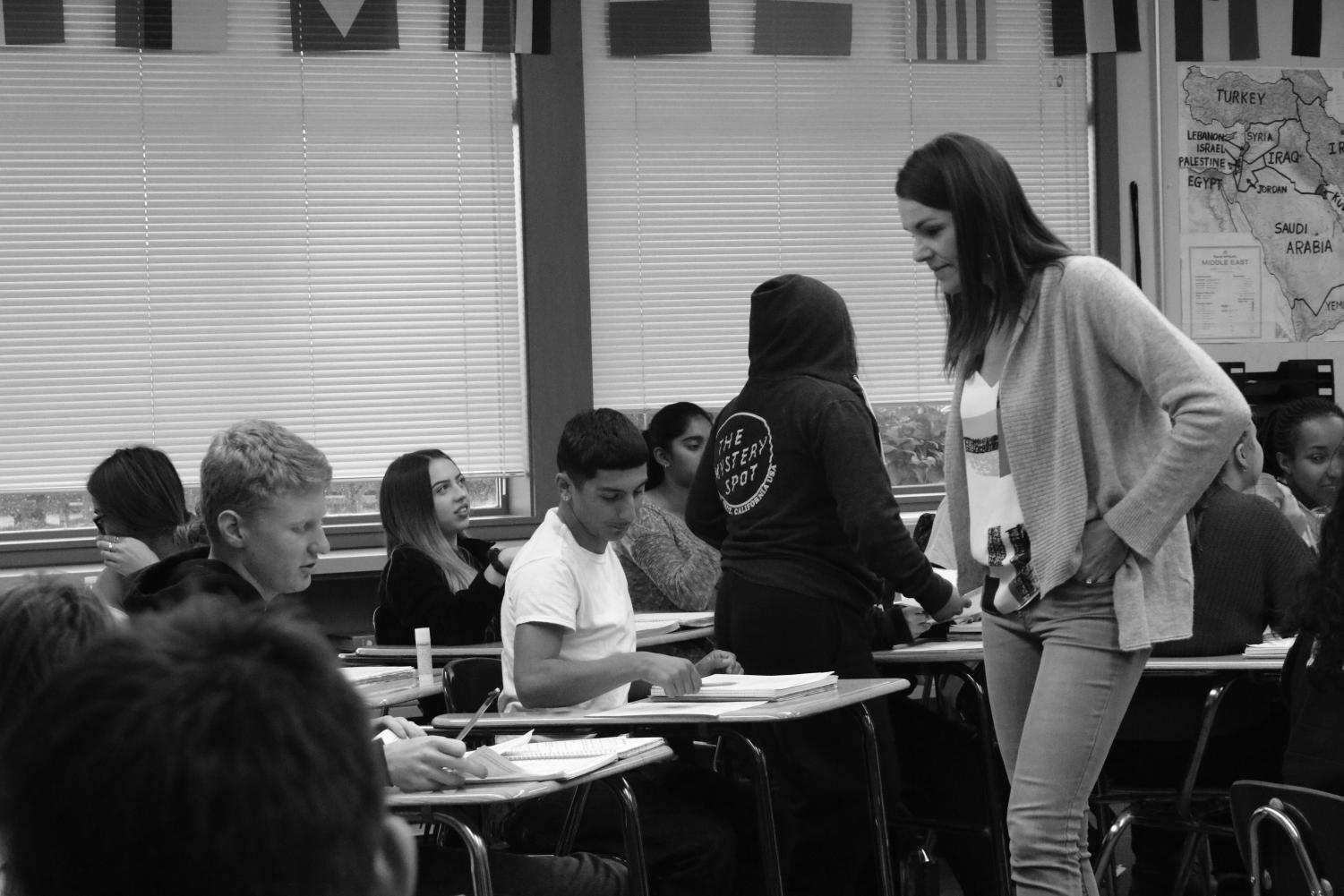 American history teacherAnja Wheeler checks in with students while they do work in class. Wheeler is one of four Cal High teachers that has started teaching their history classes thematically, rather than in the traditional chronological order.