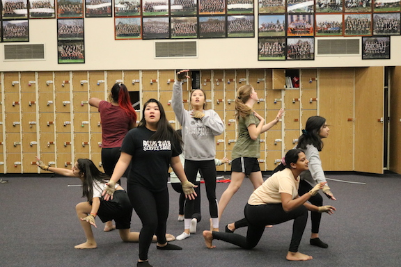 Winter Guard rehearses a symbolic scene for their performances where a Chinese immigrant on Angel Island wakes up from her nightmare.