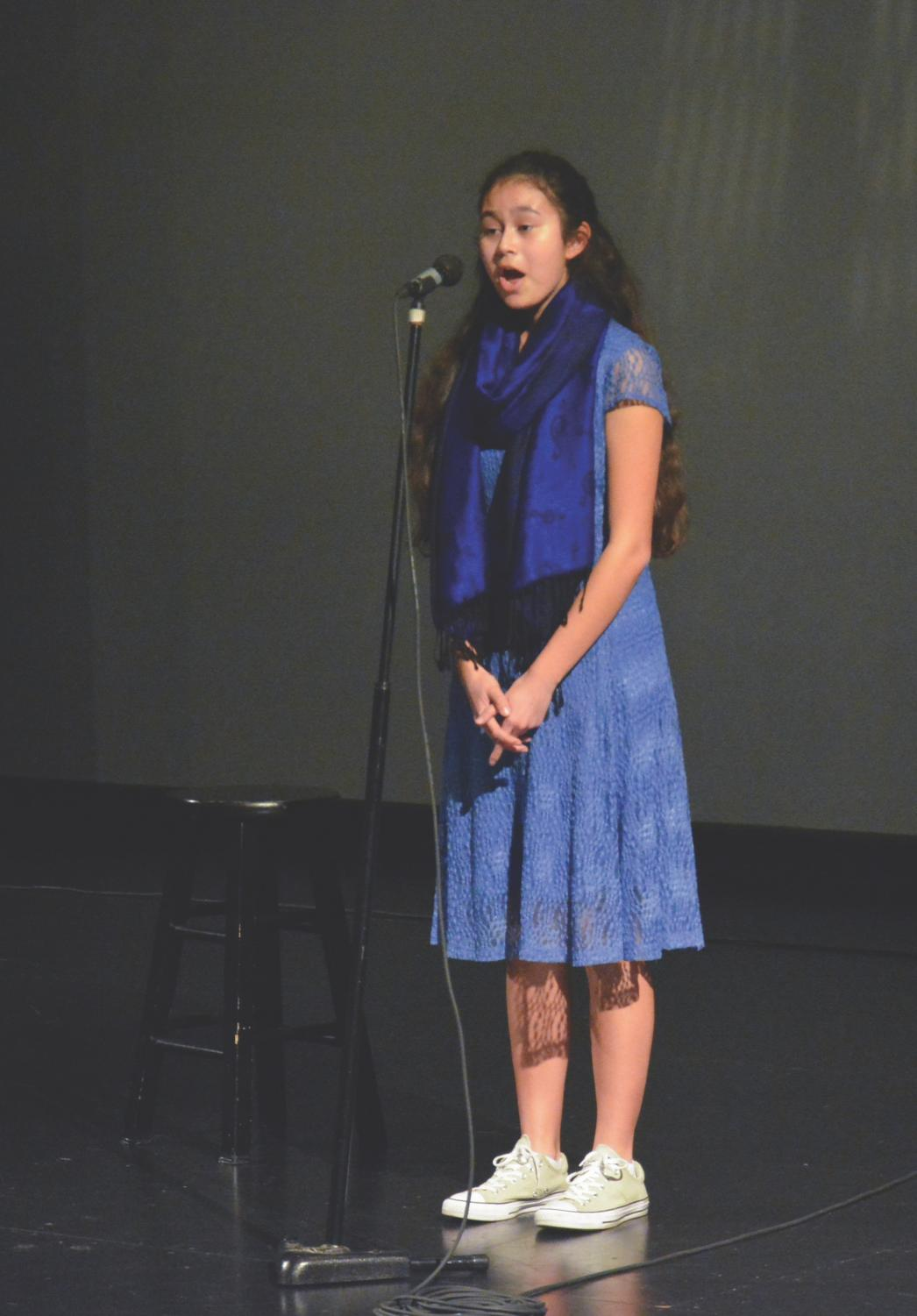 "Celeste Virador sings ""When You Wish Upon a Star"" at the school's White Noise benefit concert earlier this year."