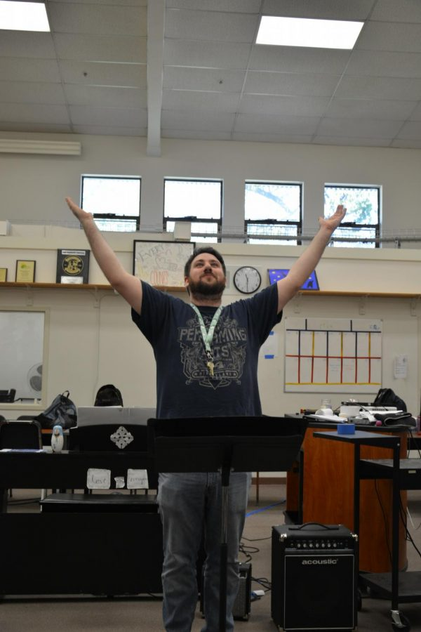 Choir+teacher+Nicholas+Patton+raises+his+hands+and+rouses+his+class+to+attention.+Patton+has+directed+Cal+High%E2%80%99s+concert%2C+treble+and+chamber+choirs+for+the+past+five+years%2C+but+he+is+leaving+the+school+this+week+due+to+personal+reasons.