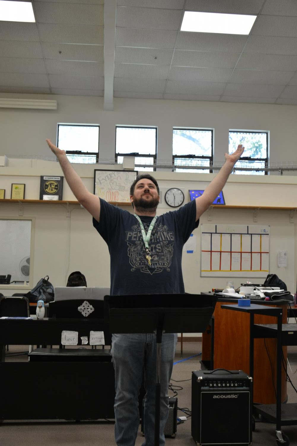 Choir teacher Nicholas Patton raises his hands and rouses his class to attention. Patton has directed Cal High's concert, treble and chamber choirs for the past five years, but he is leaving the school this week due to personal reasons.