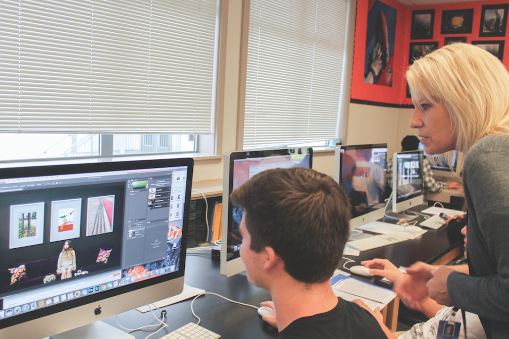 Computer graphics arts teacher Jennifer Bible helps a student operate Photoshop and work on a class project. This is her sixth year teaching at Cal High.