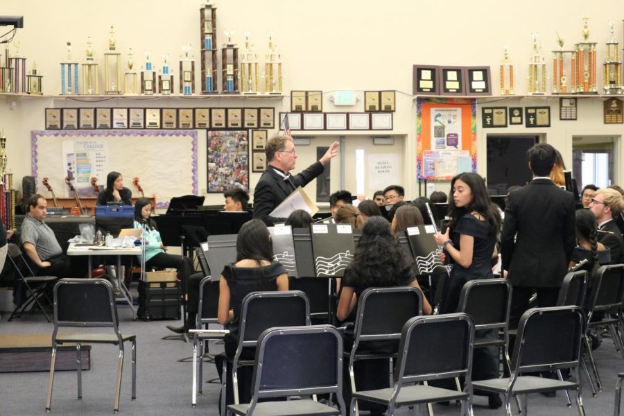 Above, Cal Band director Kent Johnson instructs wind ensemble before their sight reading session.  Below, an alto sax soloist from Pittsburg High's freshman Jazz Band performs. Schools throughout Northern California attended the festival.