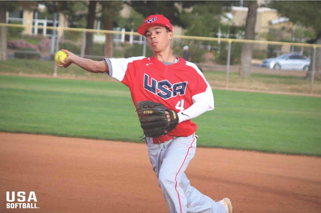 Ethan Rodriguez, who was a member of the 2018 USA National Softball team, prepares to receive a pitch.
