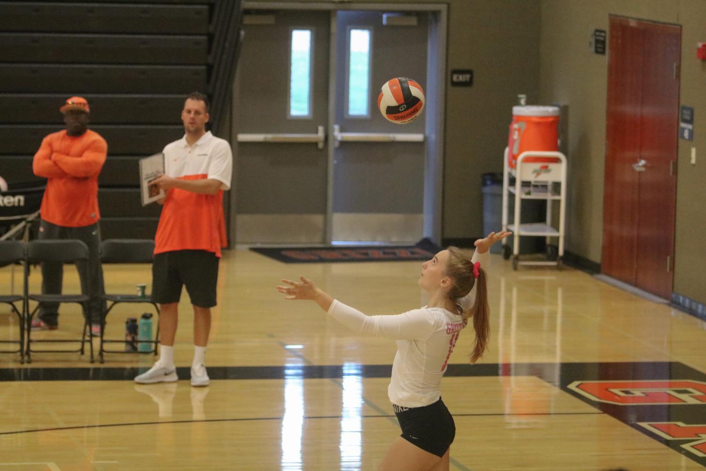 Junior McKenna Keowen prepares to serve the ball.