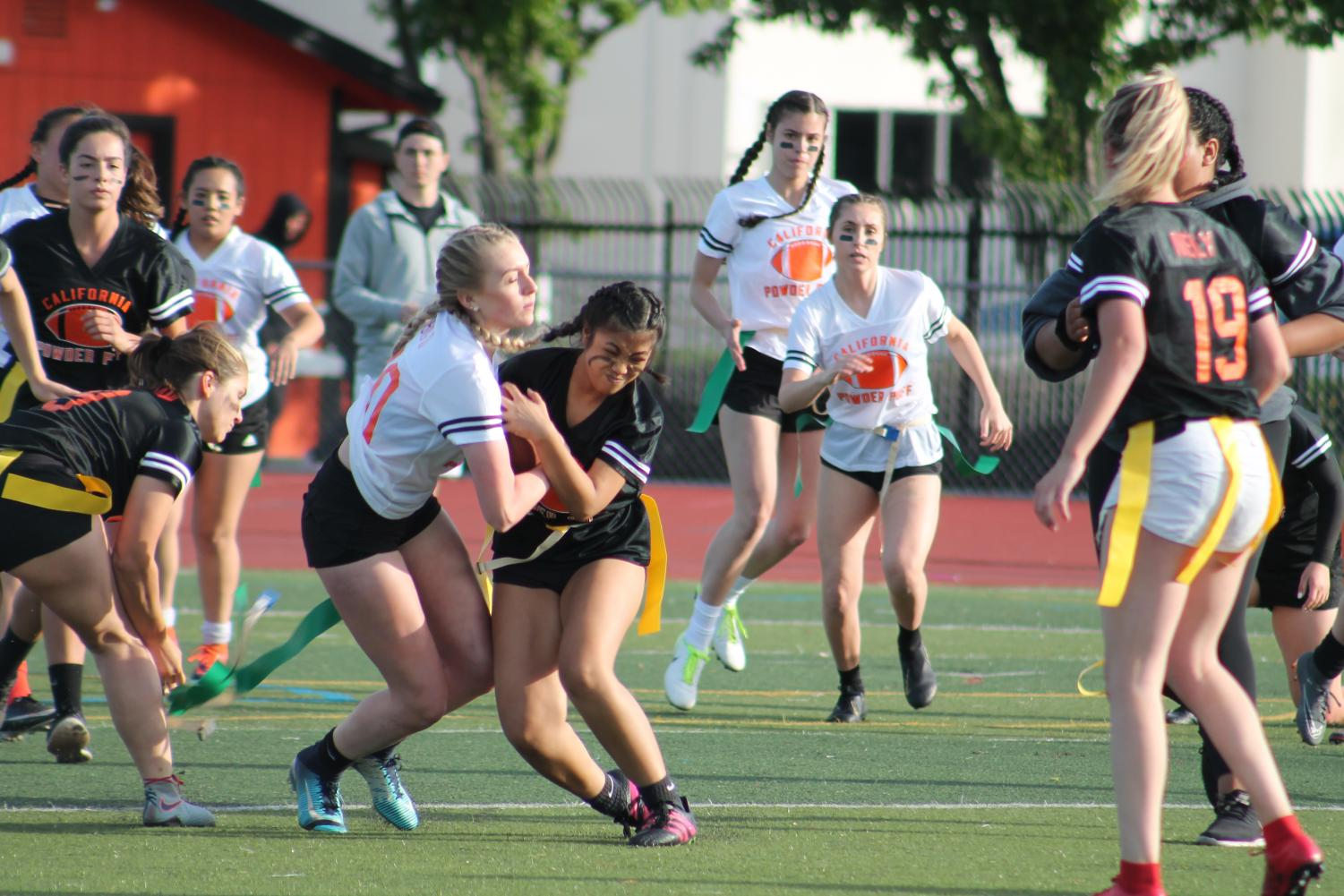 Players fight for control of the ball in last year's powderpuff game. Little did they know that this would Cal's final time hosting the event.