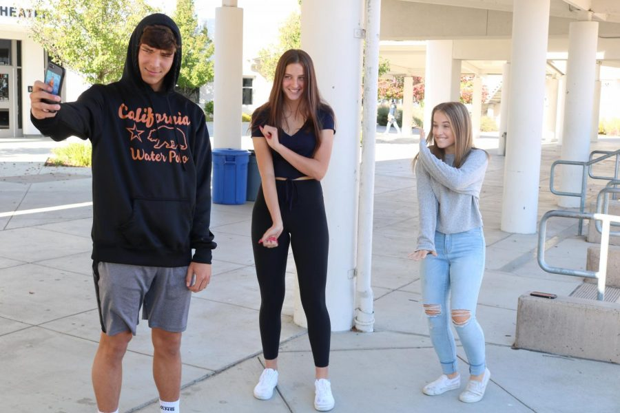 From left to right, sophomores Matt Hanson, Abbey Cullen, and Mikayla Grumley film a dance to a song on the popular app Tik Tok.