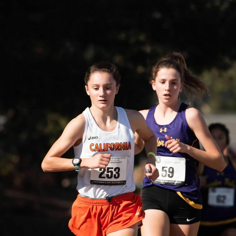 Sophomore Madison Chavez, left, ran the seventh best time in Cal's history when she posted a time of 18:52 in the five kilometer race at the CIF State Championships on Nov. 30