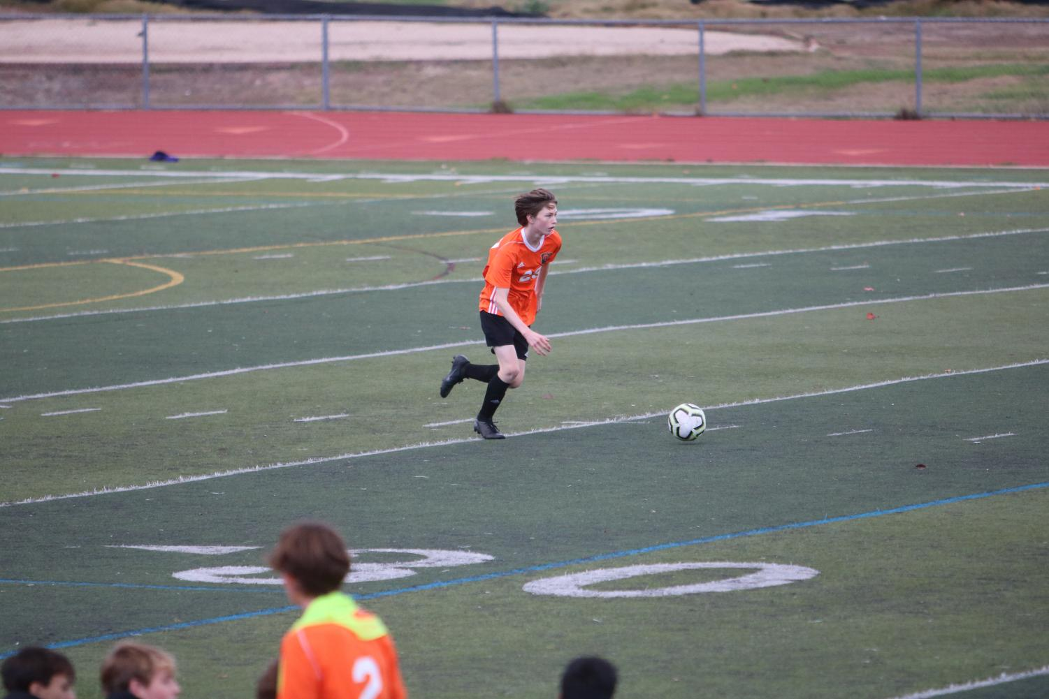 Sophomore Samuel Langfels dribbles the ball downfield in win over Moreau Catholic.