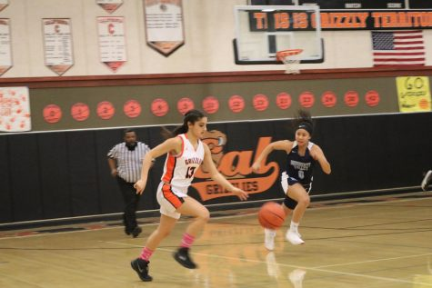Junior Awva Bashiri (13) dribbles the ball upcourt against Dougherty Valley. Cal won the game 78-42 to improve to 15-8.