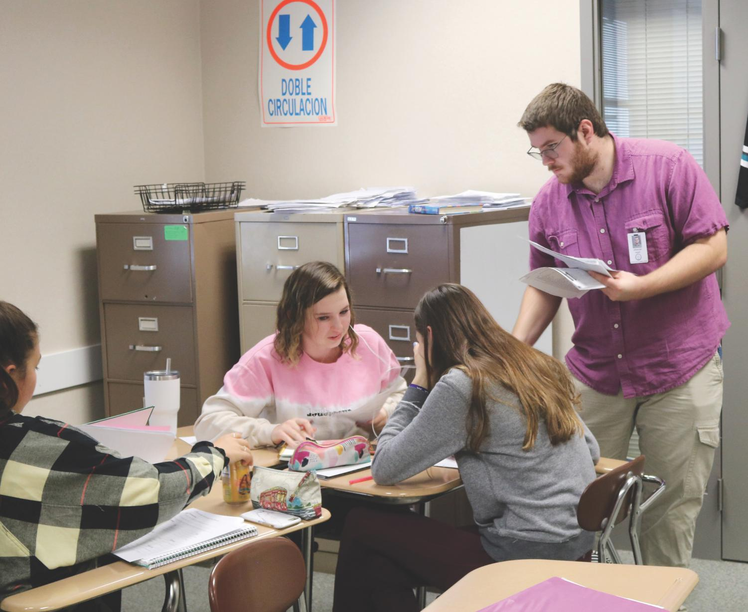 Substitute teacher Spencer Hight hands out papers to Smith's Spanish 3 students. Hight was the class's sub for 30 days between the first and second semesters. Students ares still waiting for their long-term sub to arrive.