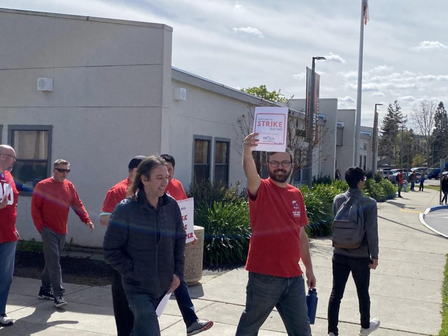 Teachers march in front of the school to communicate their hopes for improving Cal.