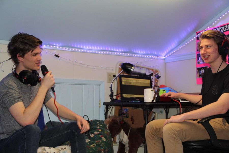 Junior Gavin Preisser, left, and senior Cameron King, right, record a Pixar podcast discussion in King's iconic attic. King's Attic Antics started earlier this school year, and has 48 podcasts that are available on Spotify.