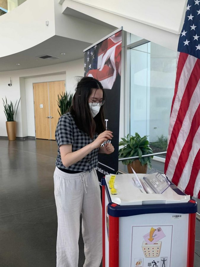 Cal High senior Kimi Shirai drops off her ballot at the dropbox inside San Ramon City Hall. Shirai is among the many Cal students participating in this year's election by either voting or volunteering.