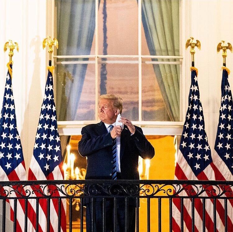 President+Trump+removing+his+mask+in+front+of+cameras+on+the+White+House+balcony+three+days+after+being+diagnosed+with+COVID-19.