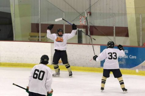 Senior Cade Llewellyn raises his arms in celebration after scoring a goal for the Tri-Valley Blue Devils 18aa-1 team. Llewellyn has traveled to several states to compete with his team and get recognized by college recruiters.