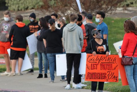 Dozens of students and parents rallied outside of campus to push for the start of high school sports.