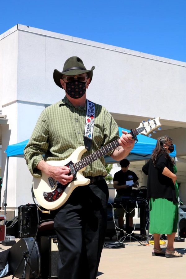 History teacher Scott Hodges plays the guitar with Partial Credit during his last performance in late May. Hodges is retiring after 23 years at Cal High.