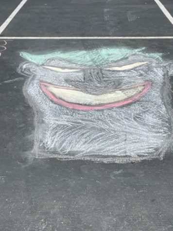 Many students created illustrations like this one for Senior Chalk Day on Aug. 9, while others decided to include racist and obscene language and inappropriate images. As a result, administrators had to get rid of all chalk illustrations before the first day of school.